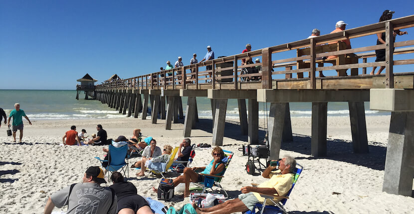 MustDo.com | The Naples Pier is one of the most popular attractions in Naples, Florida, visitors can fish from pier without a license 24 hours a day. A favorite place for family activity. Photo by Mary Carol Fitzgerald.