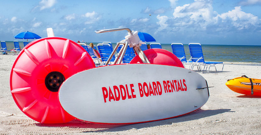 MustDo.com | Paddleboard rentals and family fun beach activities offered by Holiday Watersports Ft. Myers Beach, Florida. Must Do Visitor Guides Florida vacation information.