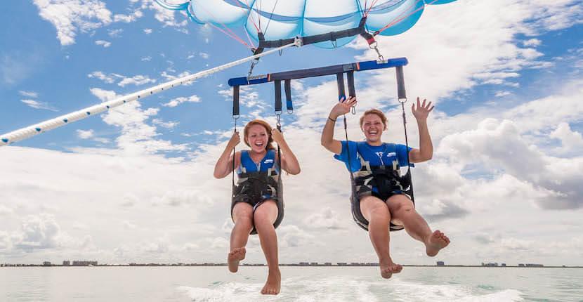 MustDo.com | Naples Beach Water Sports fun and exciting parasailing Naples, Florida USA. Photo by Debi Pittman Wilkey.