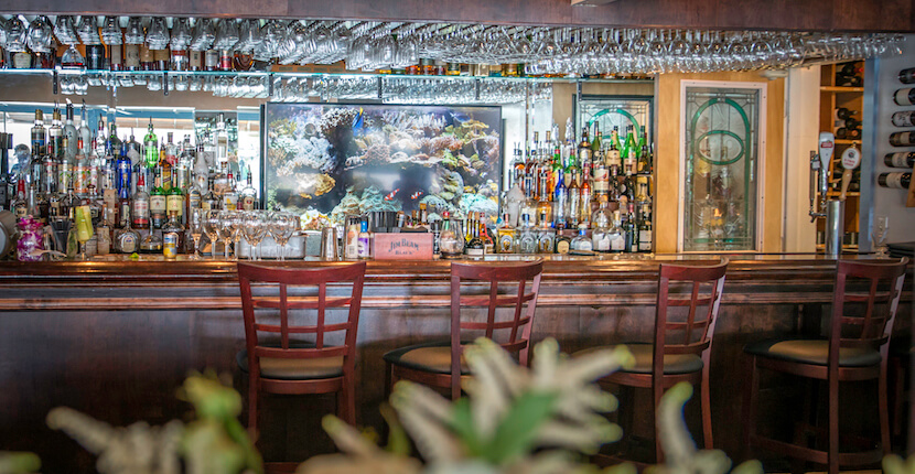 Full liquor bar, Ophelia's on the Bay waterfront fine dining restaurant Siesta Key Sarasota, Florida. Photo by Jennifer Brinkman. Must Do Visitor Guides, MustDo.com.