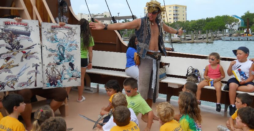 MustDo.com | Pirate entertains kids on Salty Sam's Pieces of Eight Pirate Cruise in Fort Myers Beach, Florida. Adult themed cruises are also offered. Must Do Visitor Guides Florida vacation information.