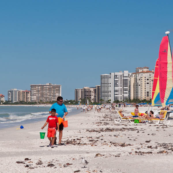 Marco Island offers a terrific beach for families to go shelling, beach fishing, or to watch dolphins playing in the surf. Photo by Debi Pittman Wilkey. Must Do Visitor Guides.