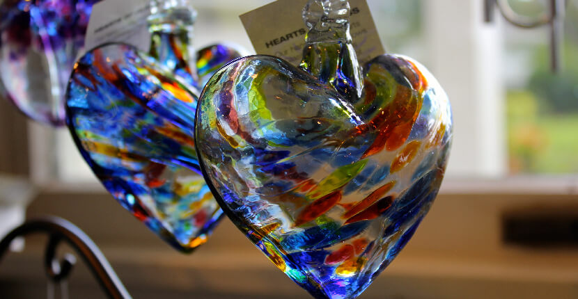 MustDo.com | Glass heart at Suncatcher's Dream gift shop in the Olde Sanibel Shops on Sanibel Island, Florida, USA. Must Do Visitor Guides Florida vacation information.