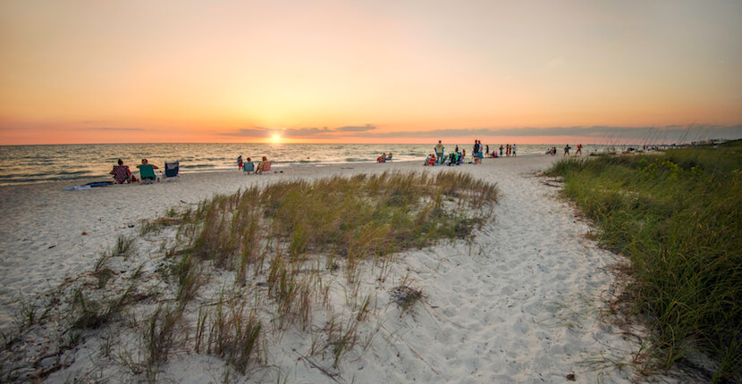 MustDo.com | Sunset at Barefoot Beach Preserve in Bonita Beach, Florida is the perfect beach choice for people wanting to enjoy a more natural beach environment surrounded by wildlife and greenery. Ideal for families, the beach offers safe swimming. Photo by Jennifer Brinkman.
