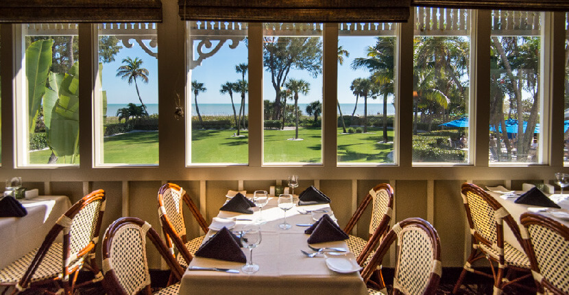 MustDo.com | Consistently voted one of the most romantic eateries in Southwest Florida, Thistle Lodge Beachfront restaurant which is located at the Casa Ybel Resort on Sanibel Island, Florida overlooks the Gulf of Mexico.