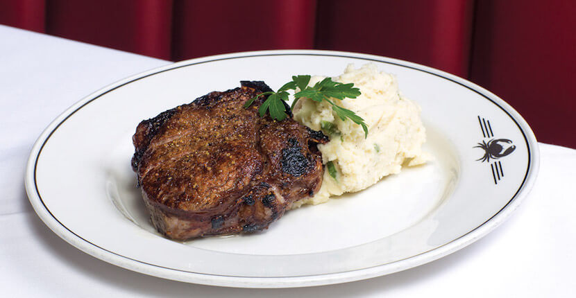 MustDo.com | Bone in filet of beef steak at Truluck's Award-Winning Steak and Seafood Restaurant in the Heart of Old Naples, Florida.