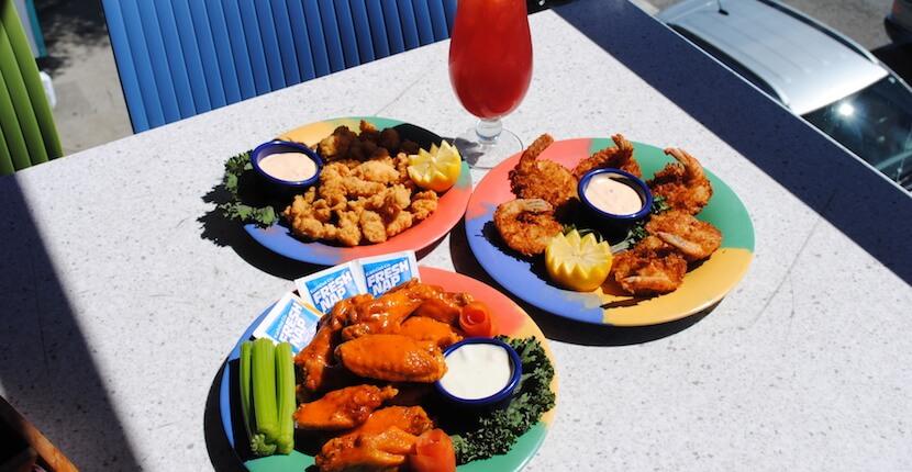 Daiquiri Deck Raw Bar buffalo wings, calamari and coconut shrimp. Restaurants in Siesta Key, St. Armands Circle Sarasota, and Venice, Florida. Must Do Visitor Guides, MustDo.com.