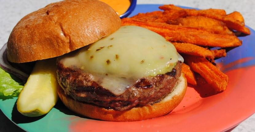Daiquiri Deck Raw Bar cheese burger with sweet potato fries. Restaurants in Siesta Key, St. Armands Circle Sarasota, and Venice, Florida. Must Do Visitor Guides, MustDo.com.