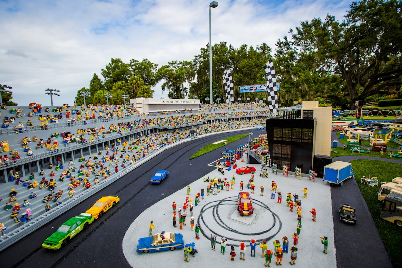 Daytona International Speedway has a sleek new look at LEGOLANDÆ Florida Resort. Itís the newest model in MINILAND USA, where visitors will discover towering LEGOÆ landmarks from across the United States. Veteran NASCAR driver Casey Mears visited the theme park today for a special event to celebrate the giant new display and to preview the NASCAR Sprint Cup Seriesí return to DIS for the Coke Zero 400 Powered By Coca-Cola on Saturday, July 2. Mears participated in a two-car race through MINILAND USA in kid-sized racing alongside a fierce competitor,10-year- old Layla Popoff of Orlando, Fla., representing Make-A- WishÆ Central and Northern Florida.(PHOTO / Chip Litherland for LEGOLAND Florida Resort). Must Do Visitor Guides, MustDo.com