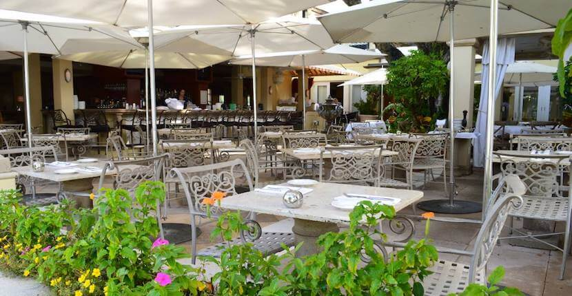 Outdoor dining along Third Street South at the historic Campiello Ristorante, Naples, Florida, USA. Must Do Visitor Guides, MustDo.com.