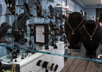 Glittering earrings, bracelets, rings, and necklaces are offered at the DanaTyler jewelry shop Tin City Naples, Florida. Photo by Mary Carol Fitzgerald. Must Do Visitor Guides, MustDo.com