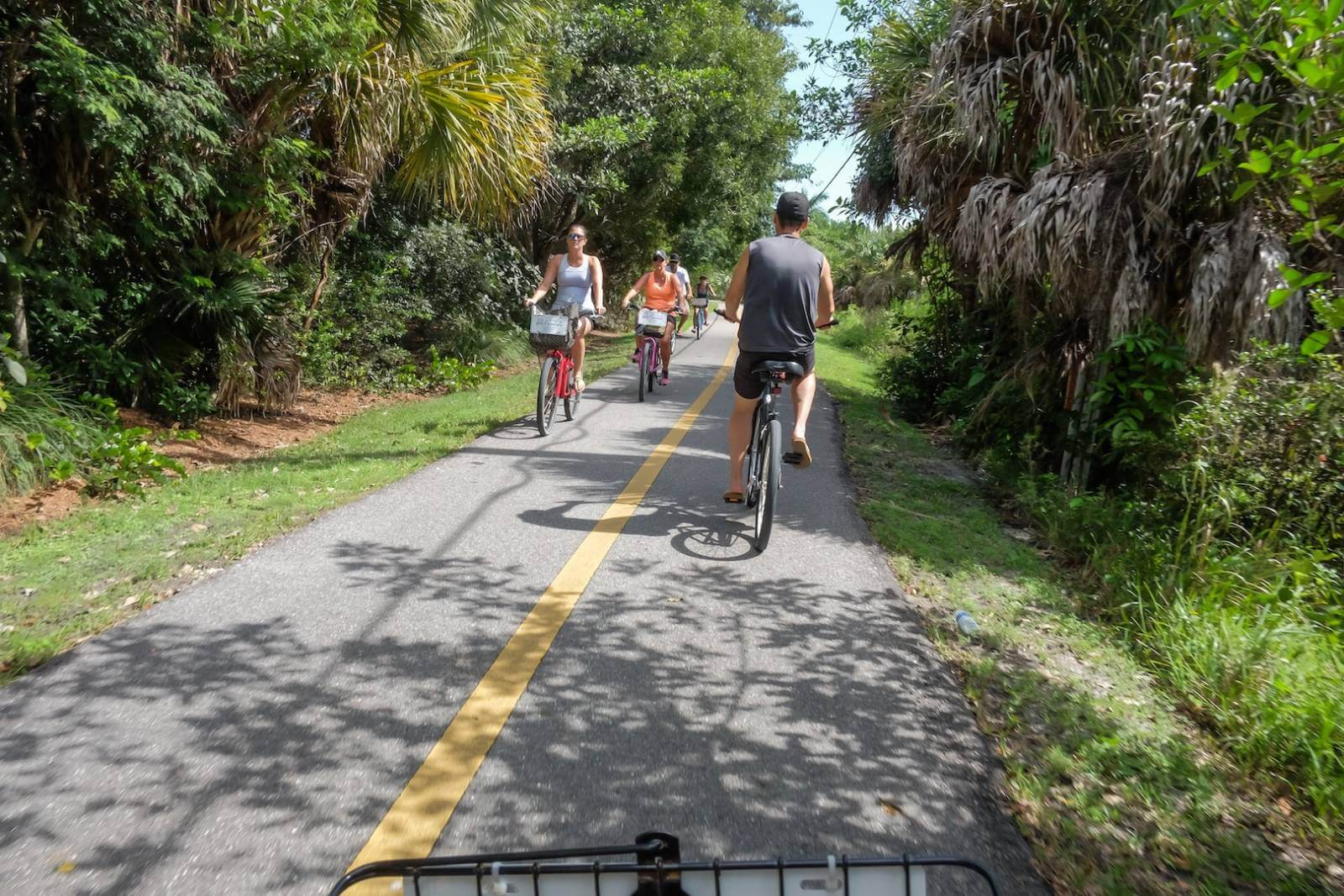 The best way to get around Sanibel Island, Florida is by renting bicycles and exploring the Island along shady bike paths. Photo by Mary Carol Fitzgerald. Must Do Visitor Guides, MustDo.com