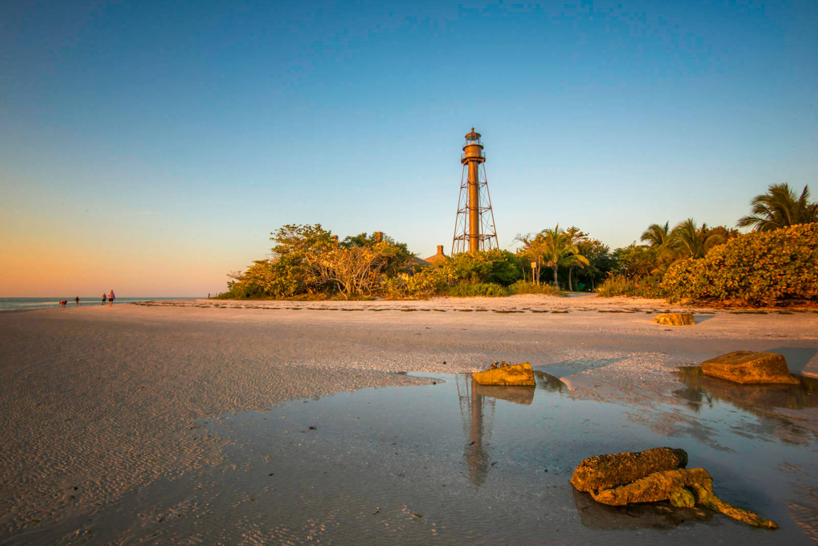 The Sanibel Lighthouse is an iconic landmark at the east end of Sanibel Island. You can't climb the 130-year-old lighthouse, but the grounds are always open for walks along the boardwalk and nature trails. Photo by Jennifer Brinkman. Must Do Visitor Guides, MustDo.com