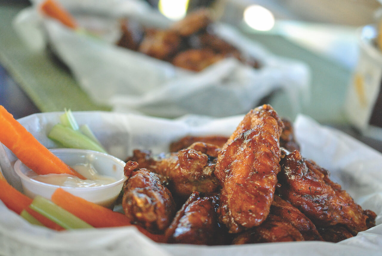 Jerk Chicken Wings Sarasota, Florida top Restaurants. Photo by Larry Hoffman dineSarasota.com. Must Do Visitor Guides, MustDo.com