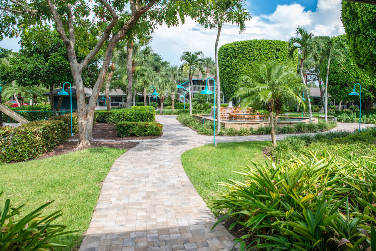 Sanibel Island, Florida. Periwinkle Place Shops are set in a 7-acre park-like setting of shady Banyan trees, covered walkways, and attractive water features. Photo by Jennifer Brinkman. Must Do Visitor Guides, MustDo.com