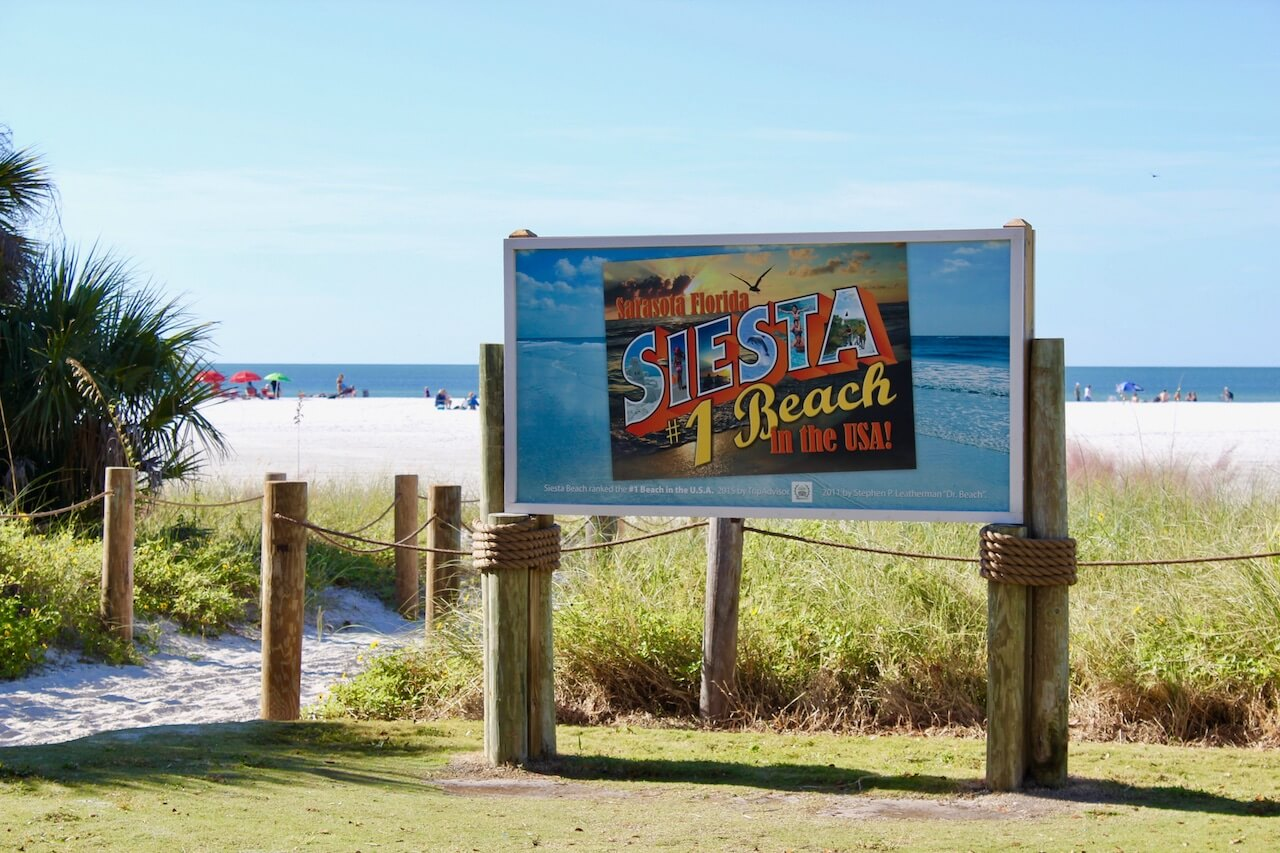Siesta Key has won a host of awards for its gorgeous white sandy beaches, including AARP #1 Best Beach in the World 2015 and Trip Advisor's #1 Travelers Choice Top Beaches USA. Siesta Beach, Siesta Key Sarasota, Florida USA. Must Do Visitor Guides, MustDo.com, Photo by Nita Ettinger