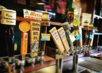 Beer on tap in The Hurricane Hole tap room and bar at Point Ybel Brewing Company Fort Myers, Florida. Must Do Visitor Guides, MustDo.com.