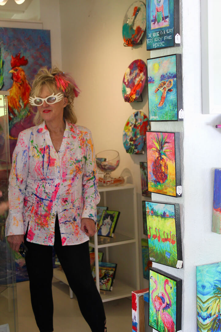 Leoma Lovegrove's Lovegrove Gallery and Gardens in Matlacha, Florida is filled with her vibrantly colorful paintings. | Must Do Visitor Guides