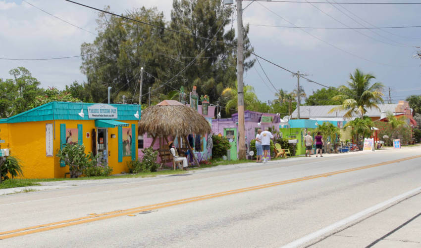 Matlacha, Florida's colorfully decorated buildings, art galleries, and Old Florida homes with their fishing boats moored just outside the door may remind you of the Florida Keys without the crowds. | Must Do Visitor Guides