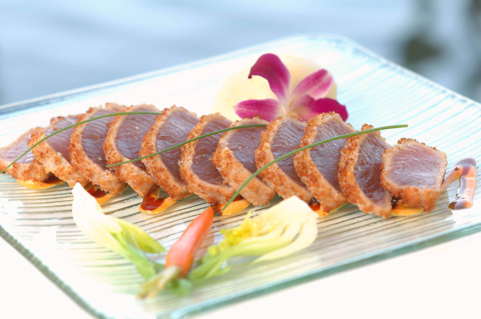 Tataki of Yellowfin Tuna with an Asian twist. Enjoy the award-winning dinner menu, fine wines, Sunday Brunch, celebrate a wedding or anniversary overlooking Little Sarasota Bay at Ophelia's on the Bay in Siesta Key, Florida. | Must Do Visitor Guides