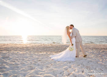 Destination Florida beach wedding. The blue Gulf waters and soft white sand create a wonderful setting for informal photographs after the ceremony, especially if your wedding coincides with a blazing pink and red sunset over the Gulf of Mexico. |MustDo.com
