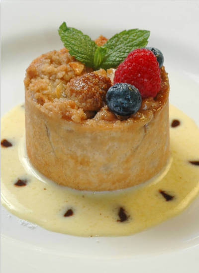 Apple Tart dessert. Enjoy the award-winning dinner menu, fine wines, Sunday Brunch, celebrate a wedding or anniversary overlooking Little Sarasota Bay at Ophelia's on the Bay in Siesta Key, Florida. | Must Do Visitor Guides