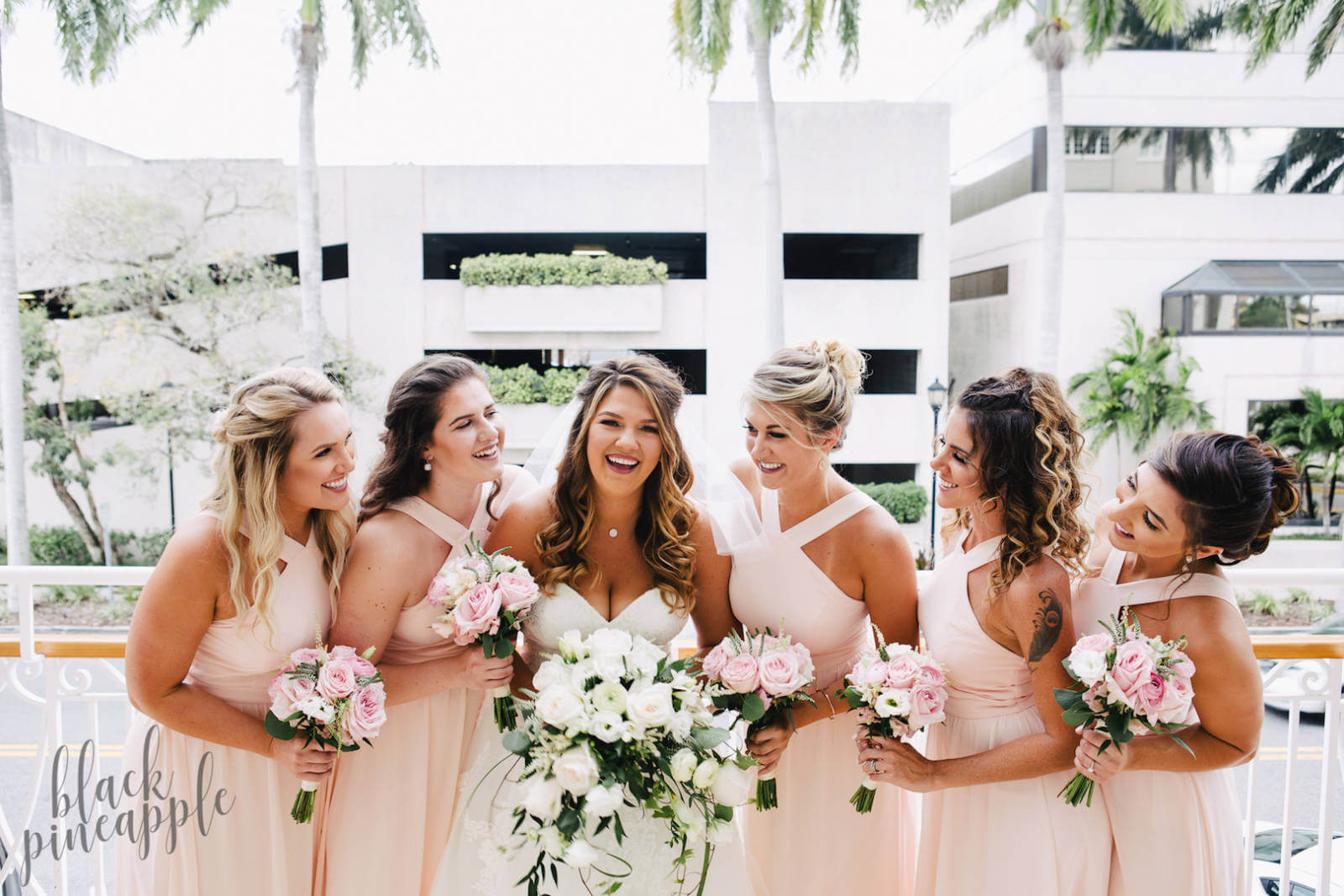 The sunny climate, beautiful white sandy beaches, flaming sunsets, professional photographers, florists, top caterers, and superb resorts make it easy to plan your dream beach wedding in Southwest Florida. Photo by Elizabeth Barnett Black Pineapple Photography | MustDo.com