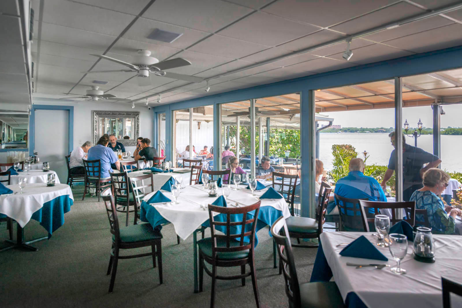 Enjoy the award-winning dinner menu, fine wines, Sunday Brunch, celebrate a wedding or anniversary overlooking Little Sarasota Bay at Ophelia's on the Bay in Siesta Key, Florida. Photo by Jennifer Brinkman | Must Do Visitor Guides