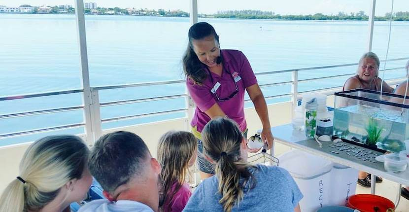 Kids and adults love the hands-on marine wildlife experience on Sarasota Bay Explorers' Sea life eco tour boat cruise, Sarasota, Florida, USA. | Must Do Visitor Guides, MustDo.com