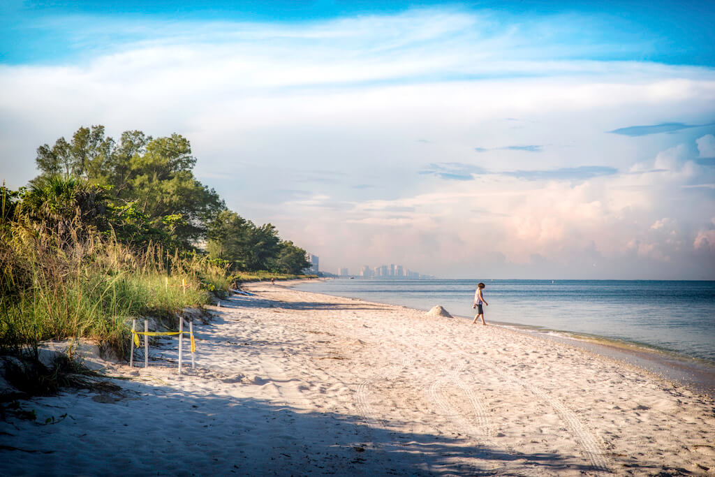 Barefoot Beach and Delnor-Wiggins Pass State Park in Naples, Florida are the perfect choice for those who prefer to spend their days walking, shelling, swimming, boating, and relaxing on the beach surrounded by nature. Photo by Jennifer Brinkman.