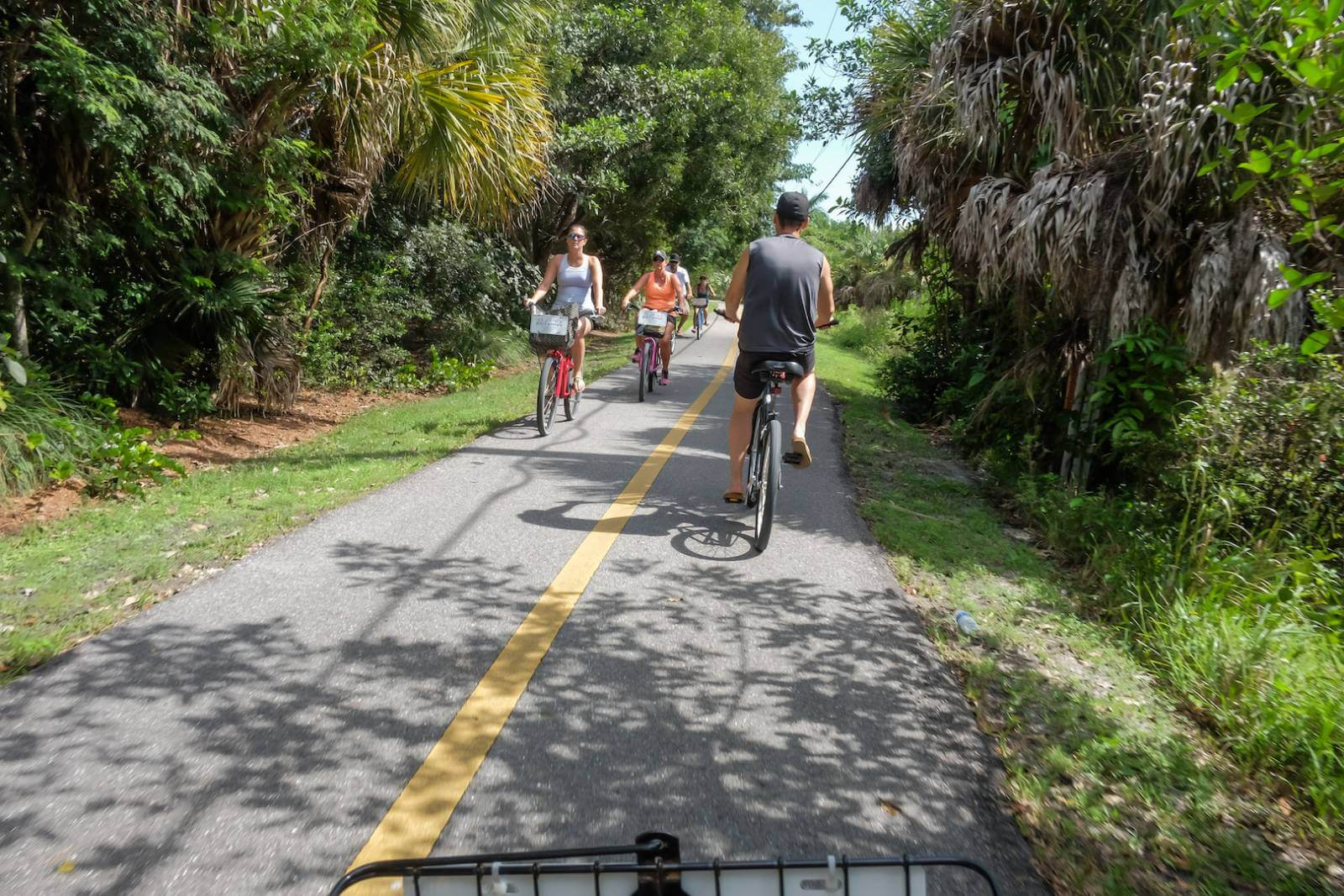 The best way to get around Sanibel and Captiva, Florida is by bicycle. The islands have 22 miles of shady traffic-free bike trails – and no stop lights! Photo by Mary Carol Fitzgerald. #Florida #vacationideas #biketrails #Sanibel #activities #familyfun