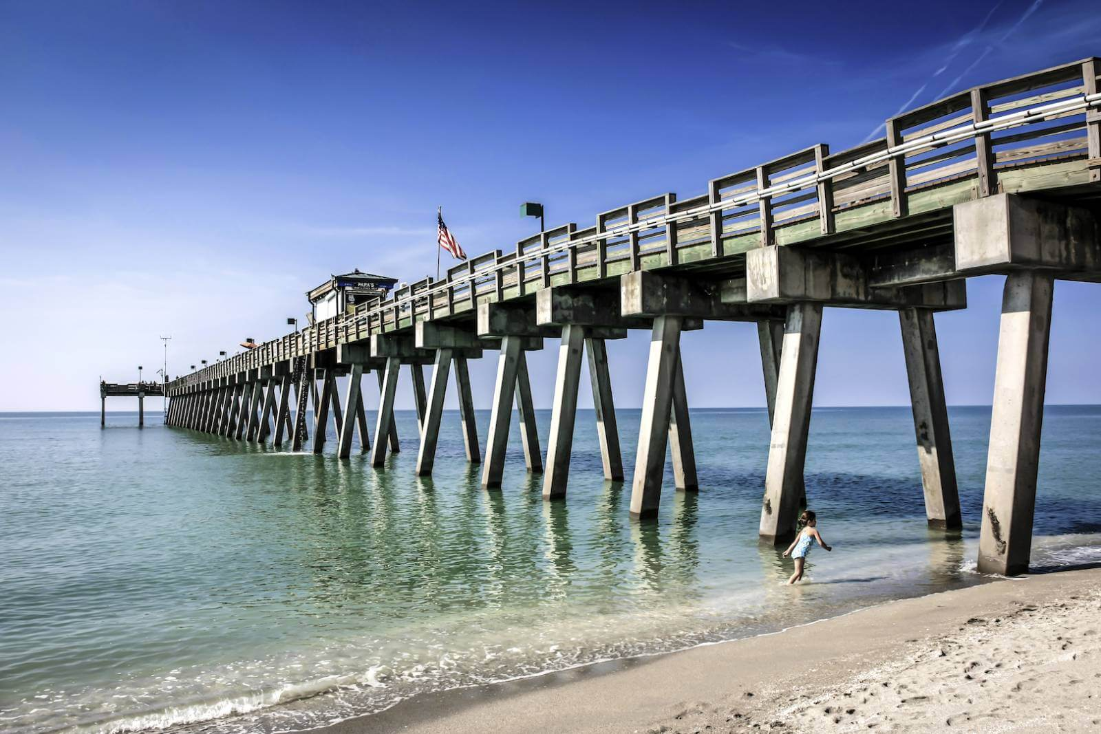 The Venice Pier is 720 feet long, 22 feet wide, and 20 feet high. It stands in water up to 18 feet deep. | Photo by Chris L. Smith #VeniceFlorida