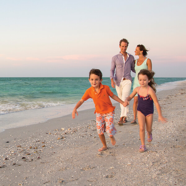 Family on the beach at Sundial Beach Resort on Sanibel, Florida