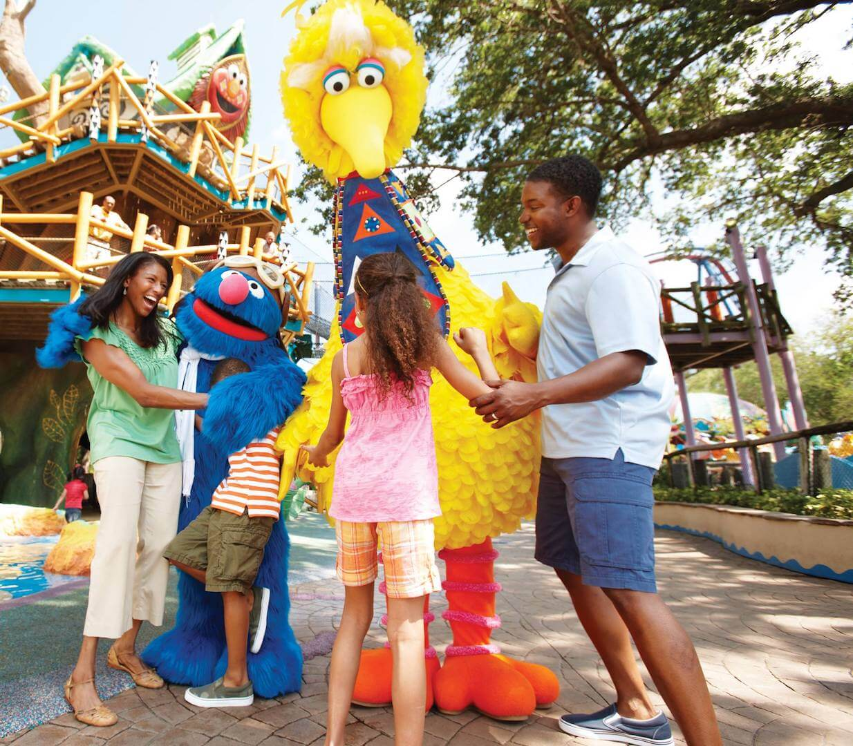 Family with Big Bird at Sesame Street Safari of Fun Busch Gardens Tampa Bay. Must Do Visitor Guides, MustDo.com.
