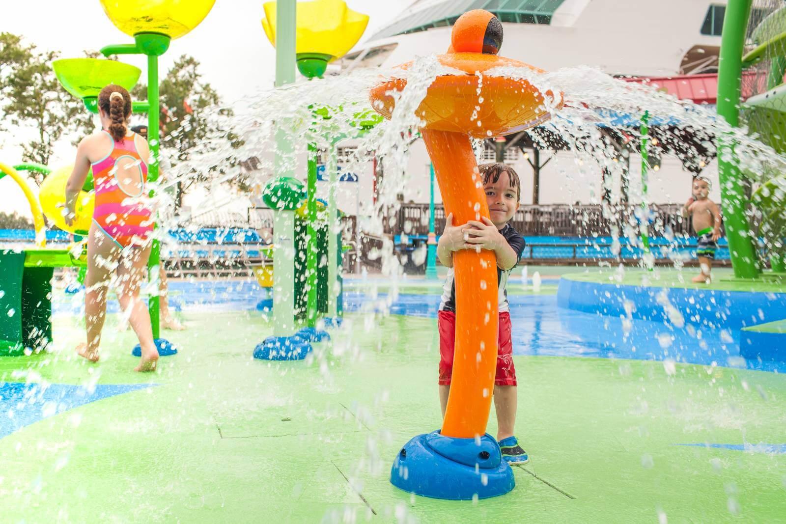 Kids at the splash pad water park and playground at The Florida Aquarium in Tampa.