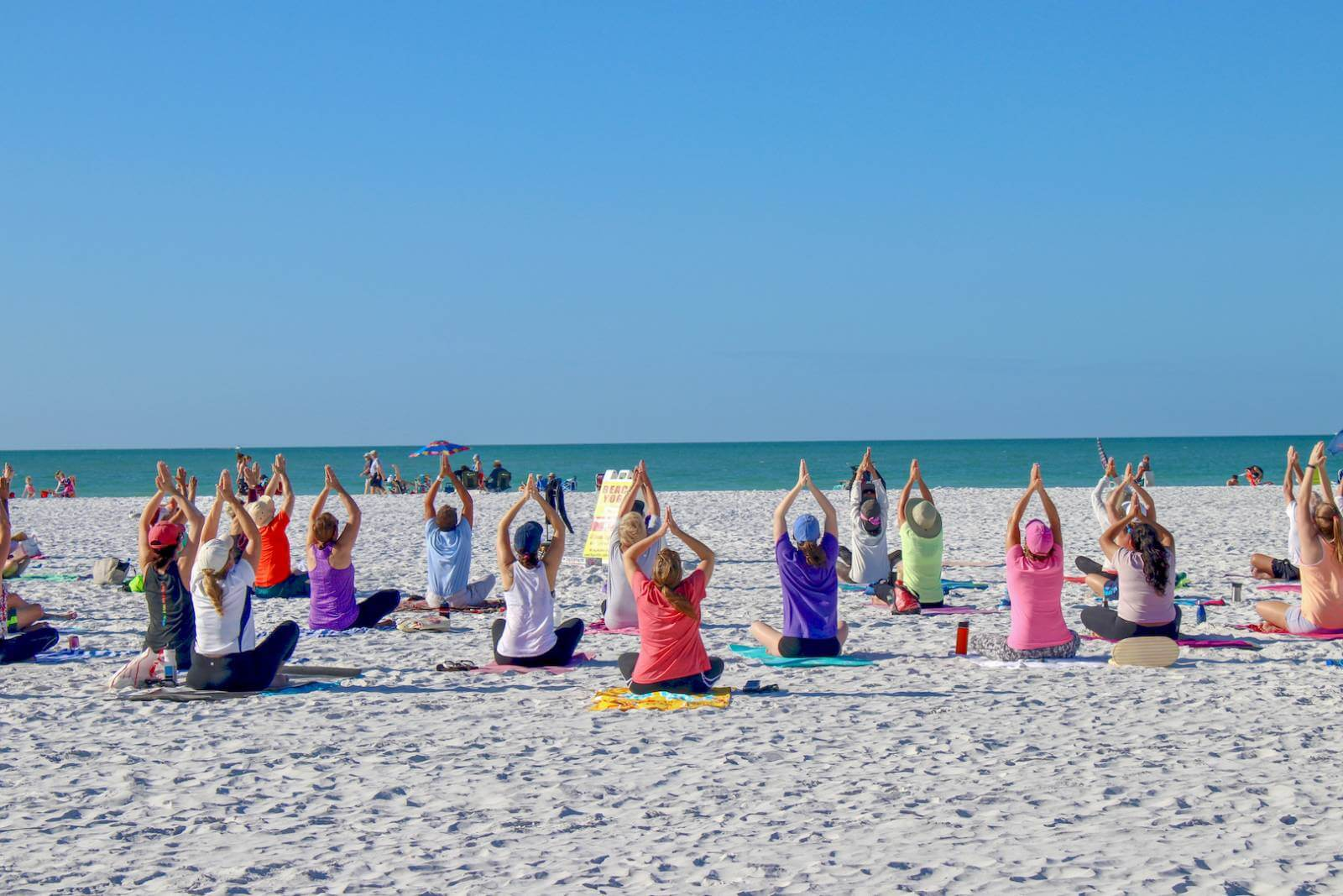 Free Yoga on Siesta Beach on Siesta Key in Sarasota, Florida USA. Photo by Nita Ettinger. Must Do Visitor Guides, MustDo.com.