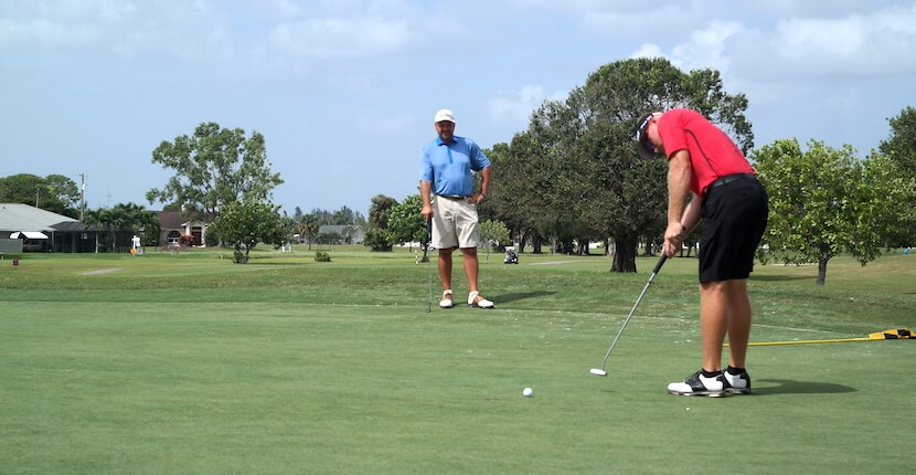 Putting on the green at Coral Oaks Golf Course in Cape Coral near Fort Myers, Florida. Must Do Visitor Guides, MustDo.com.
