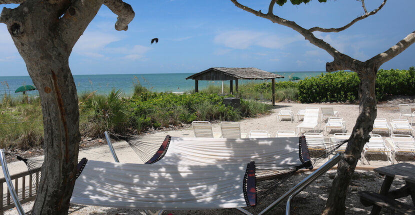 Relax in a hammock on the beach at Island Inn resort on Sanibel, Florida. Must Do Visitor Guides, MustDo.com