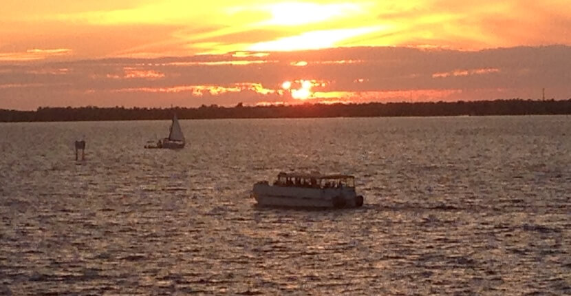 Watch a spectacular sunset over the Caloosahatchee River on a 90-minute Pure Florida sunset river cruise. Fort Myers, Florida. Must Do Visitor Guides, MustDo.com