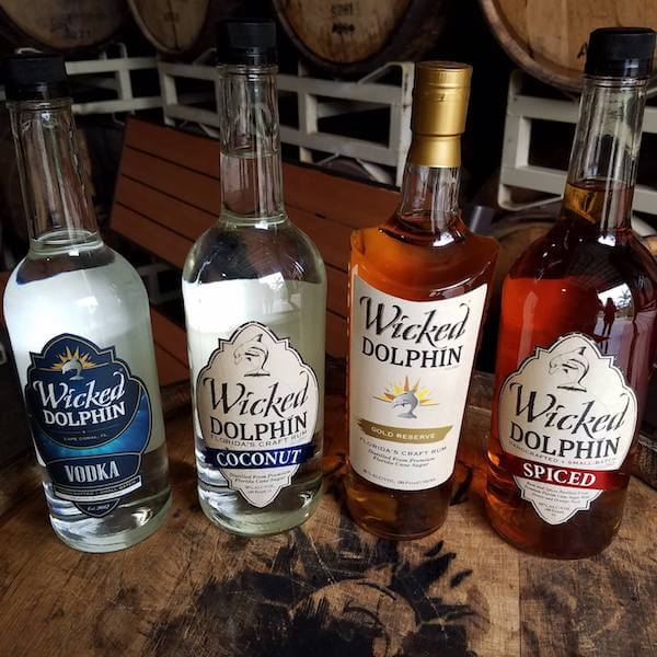 Craft rum on display. Free distillery tours and tastings of award-winning Wicked Dolphin Rum where you'll learn how they cook, ferment, and distill their reserve and signature rums. Cape Coral, Florida. Must Do Visitor Guides, MustDo.com.