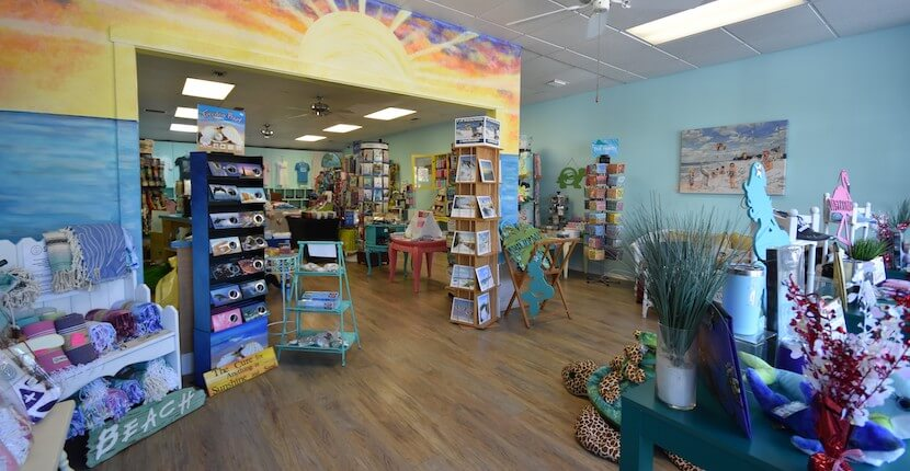 Sunshine & Sand Hidden Treasures is a Siesta Key shop offering beach and coastal themed souvenirs, gifts, home decor, artwork, jewelry, t-shirts, hats, and more including