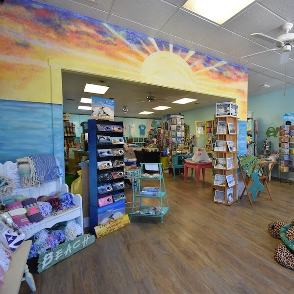 "Sunshine & Sand Hidden Treasures is a Siesta Key shop offering beach and coastal themed souvenirs, gifts, home decor, artwork, jewelry, t-shirts, hats, and more including ""products with a purpose"" such as t-shirts made from recycled plastic bottles and bracelets made from recycled glass. Must Do Visitor Guides 