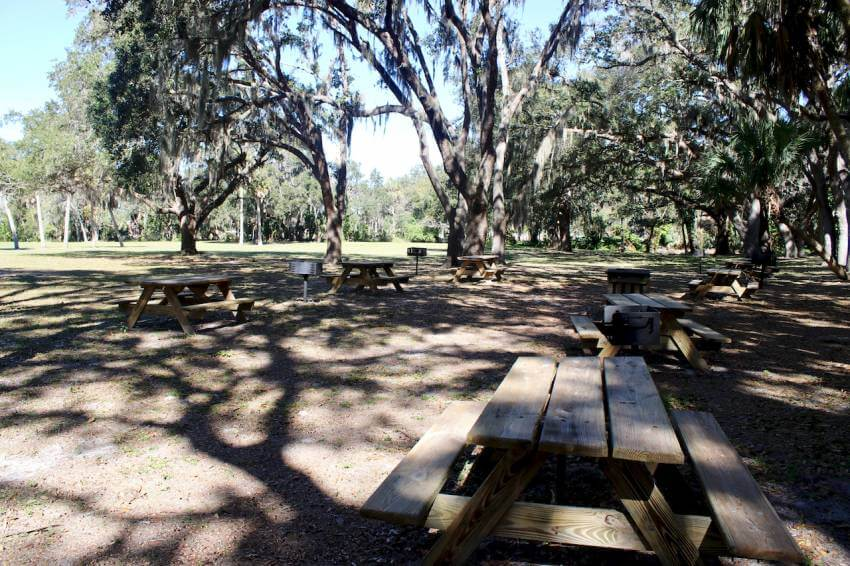 Shaded picnic area at Gamble Plantation Historic State Park Ellenton, Florida. The Gamble Plantation in Ellenton is an easy day trip from Sarasota, Florida. The antebellum mansion is the only surviving plantation home in South Florida and was once the headquarters of an extensive sugar plantation. Photo by Nita Ettinger. Must Do Visitor Guides | MustDo.com