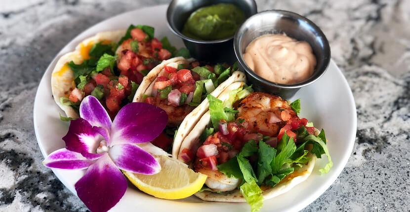 Blackened shrimp tacos Daiquiri Deck Raw Bar restaurants in Siesta Key, St. Armands Circle, Sarasota, and Venice, Florida. Must Do Visitor Guides, MustDo.com.