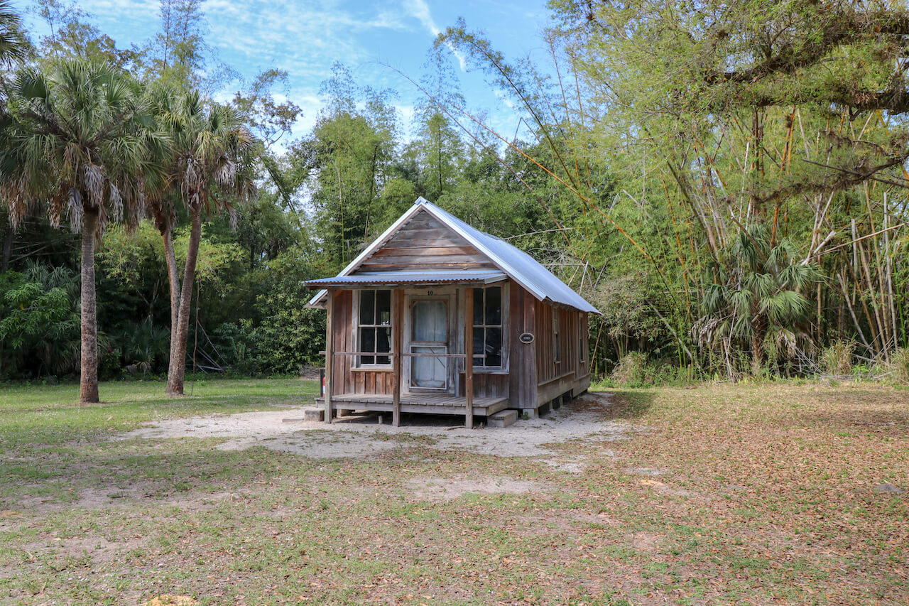 Koreshan State Park is the preserved site of a 19th century religious community. The 200-acre park includes 11 original buildings, Victorian gardens, a nature trail along the Estero River, canoeing, and camping. Must Do Visitor Guides | MustDo.com. Photo by Nita Ettinger