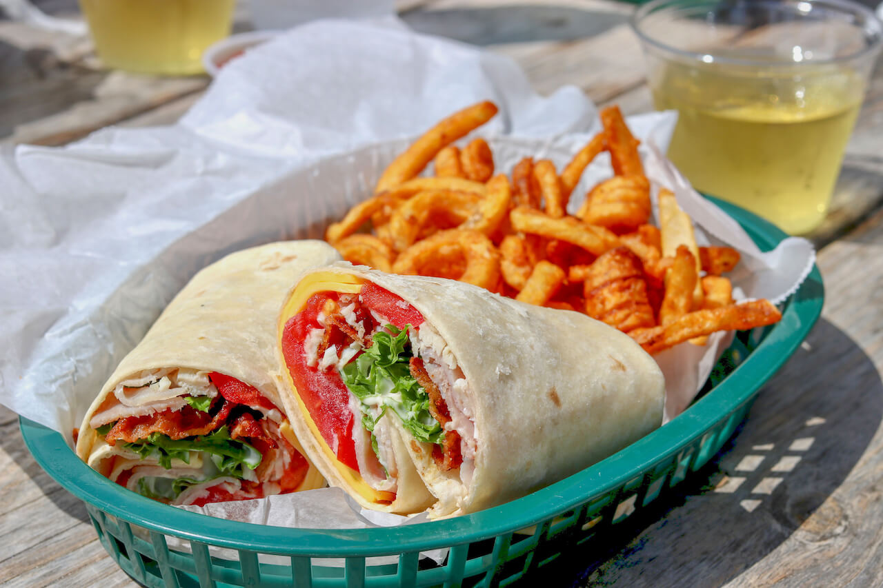 Turkey Club Wrap O'Leary's Tiki Bar & Grill Waterfront Restaurant is a casual tropical-themed, pet and family-friendly downtown Sarasota, Florida restaurant and bar located in Bayfront Park and features live music daily. Photo by Nita Ettinger. Must Do Visitor Guides | MustDo.com