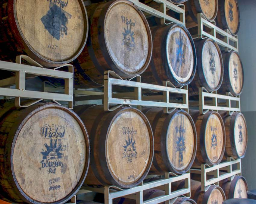 Barrel room at Wicked Dolphin Rum Distillery. Take a free distillery tour that includes tastings of award-winning Wicked Dolphin Rum in Cape Coral, Florida where you'll learn how they cook, ferment, and distill their reserve and signature rums! Photo by Nita Ettinger. Must Do Visitor Guides   MustDo.com
