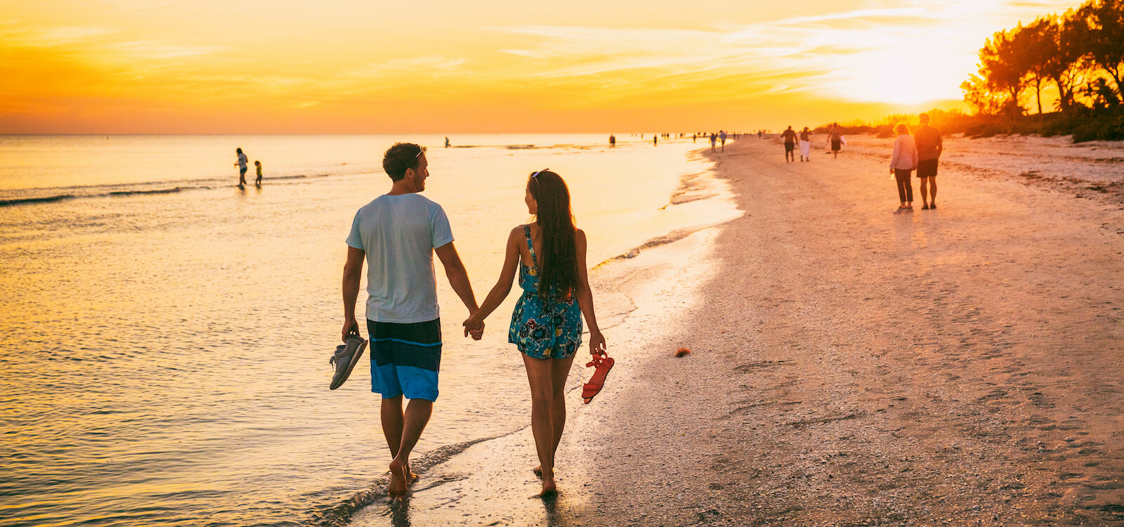 Sunset walk on the beach in Sarasota, Florida. Must Do Visitor Guides | MustDo.com