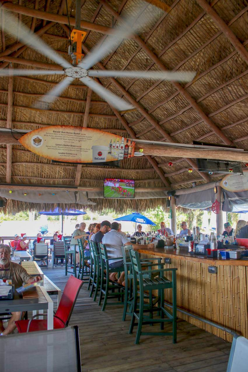 The perfect spot for lunch, dinner or sunset drinks - Evie's at Spanish Point. Waterfront Tiki Bar & Restaurant just minutes from Venice and Siesta Key, Florida on Little Sarasota Bay. Must Do Visitor Guides | MustDo.com