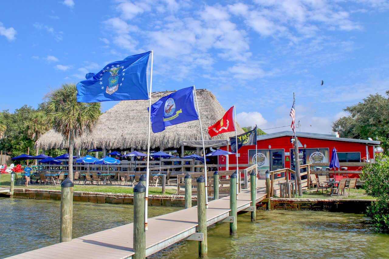 Evie's at Spanish Point casual waterfront restaurant and tiki bar Sarasota, Florida. Arrive by car or boat. Must Do Visitor Guides | MustDo.com.
